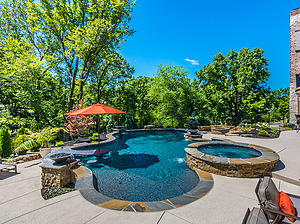 st louis pool construction, custom concrete pool, flagstone coping, textured deck