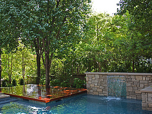 st louis pool construction, custom concrete pool, raised wall, sheer descent, wood deck