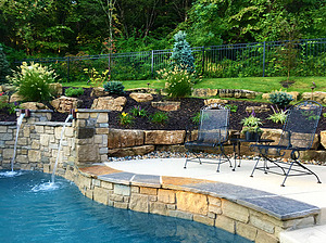 st louis pool construction, custom concrete pool, raised wall, scupper, flagstone coping