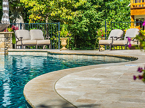 st louis pool construction, custom concrete pool, freeform, travertine patio