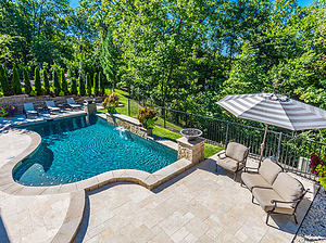 st louis pool construction, custom concrete pool, travertine patio