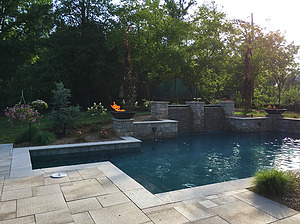 st louis pool construction, custom concrete pool, fire bowl, raised wall, paver deck