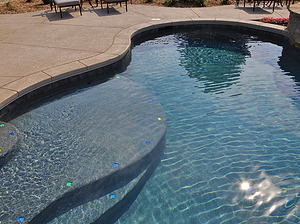 st louis pool construction, custom concrete pool, stair entry, tan shelf, accent tiles