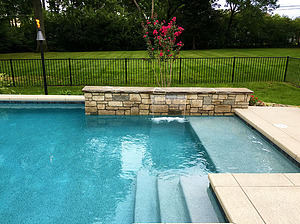 st louis pool construction, custom concrete pool, stair entry, tan shelf, raised wall, sheer descent