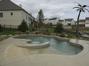 st louis pool construction, custom concrete pool, freeform, beach entry