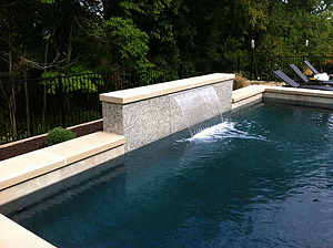 st louis pool construction, custom concrete pool, sheer descent, raised wall, pebble finish