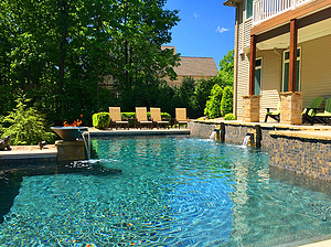 st louis pool construction, custom concrete pool, pebble finish, scupper, water bowl, fire bowl