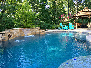 st louis pool construction, custom concrete pool, raised wall, sheer descent, pebble finish
