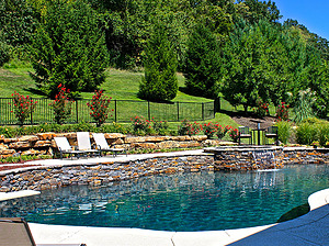 st louis pool construction, custom concrete pool, raised wall, pebble finish