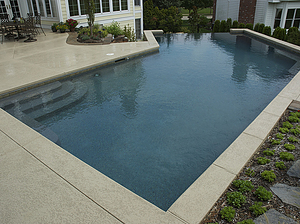 st louis pool construction, custom concrete pool, pebble finish, vanishing edge