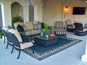 st. louis pool construction, black outdoor furniture with plush tan cushions, area rug, entertainment system