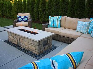 st. louis pool construction, brown wicker outdoor furniture with ivory cushions and blue pillows, fire pit