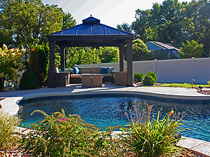 st. louis pool construction, brown wicker outdoor furniture with tan cushions, gazebo, fire table