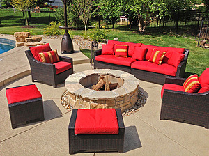 st. louis pool construction, brown wicker outdoor furniture with red cushions, fire pit