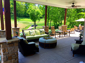 st. louis pool construction, brown wicker outdoor furniture with green cushions