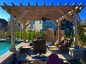 st. louis pool construction, metal outdoor furniture with tan and red cushions, wooden pergola