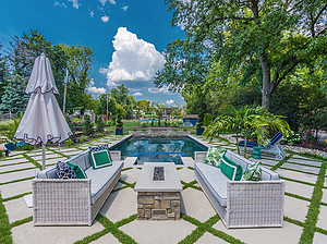 st. louis pool construction, white wicker outdoor furniture with colorful pillows, fire pit