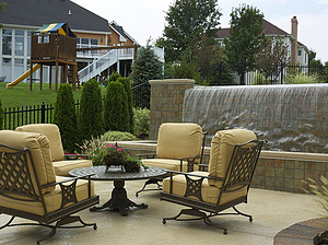 st. louis pool construction, metal outdoor furniture with plush tan cushions, vanishing edge