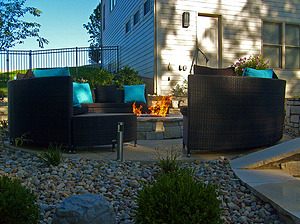 st. louis pool construction, black wicker outdoor furniture with blue pillows, fire pit
