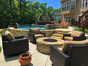 st. louis pool construction, brown wicker outdoor furniture with tan cushions, fire pit