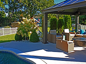 st. louis pool construction, brown wicker outdoor furniture with tan cushions, fire table, gazebo