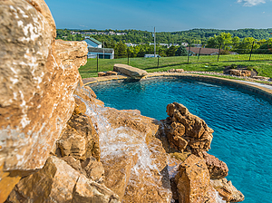 st. louis custom designed concrete pool with waterfall and jumping rock