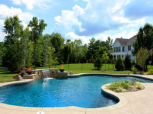 freeform st. louis custom designed concrete pool with sheer descent and fire bowls