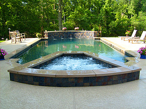 st. louis custom designed grecian concrete pool with raised wall, medallions and raised concrete spa