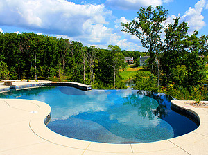 st. louis custom designed freeform concrete pool with cantilever coping and vanishing edge