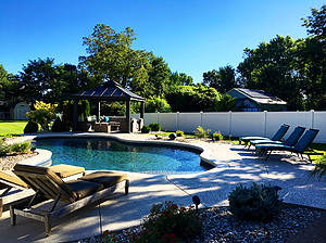 st. louis custom designed concrete pool with pagoda and lounge chair seating on deck