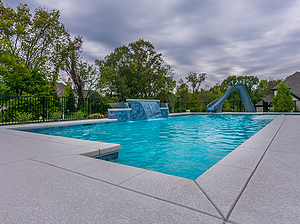st. louis custom designed concrete pool with slide and sheer descent, geometric shape