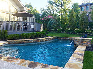st. louis custom designed concrete pool with scuppers and flagstone coping