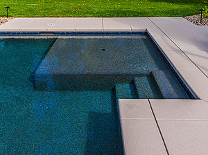 stairs and tanning shelf in geometric st. louis custom designed concrete pool