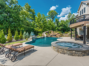 freeform st. louis custom designed concrete pool with spa, waterfall and slide