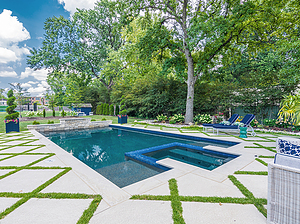 geometric st. louis custom designed concrete pool with spa, grass diamond pattern on concrete pool deck