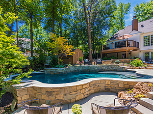 heavily shaded freeform st. louis custom designed concrete pool with raised wall