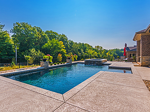 geometric st. louis custom designed concrete pool with fire bowls and spa