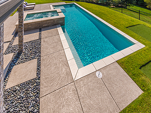 geometric st. louis custom designed concrete pool with spa and putting green