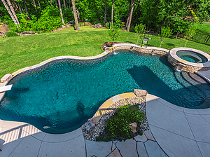 freeform st. louis custom designed concrete pool with spa and diving board
