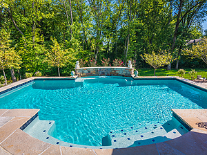st. louis custom designed concrete pool with sheer descent and flagstone patio