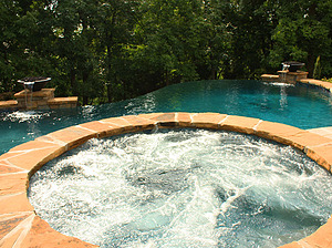 st. louis custom designed concrete pool, raised concrete spa with flagstone coping