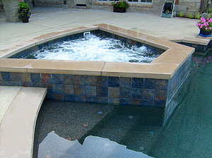 st. louis custom designed concrete pool, raised concrete spa with tile veneer and limestone coping