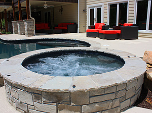 st. louis custom designed concrete pool, concrete spa with stone veneer and flagstone coping