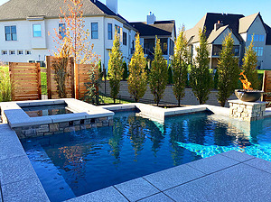 st. louis custom designed concrete pool, raised concrete spa with textured concrete coping, scuppers, fire bowl