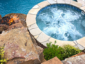 st. louis custom designed concrete pool, concrete spa with flagstone coping, fire feature