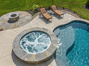st. louis custom designed concrete pool, raised concrete spa with stone veneer and blue flagstone coping